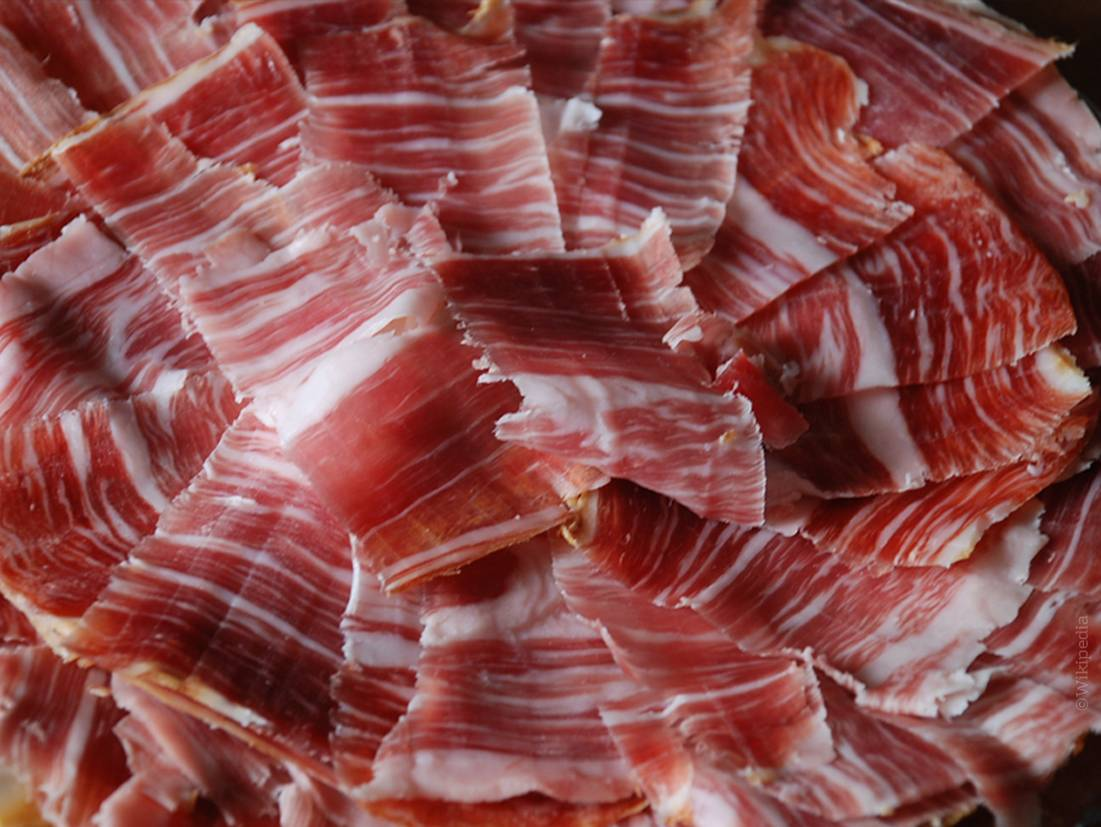 Freshly sliced acorn-fed Iberian ham